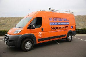 911-restoration-water-damage-mold-remediation-fire-damage-person-van-side-angle